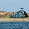 The iconic Blakeney lifeboat house from the water