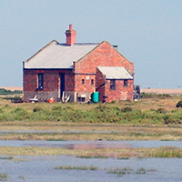The Blakeney Point Watch House on a high Spring tide
